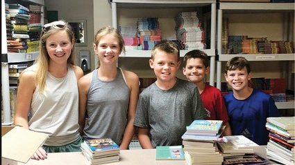 Local family lends a hand to Link to Libraries